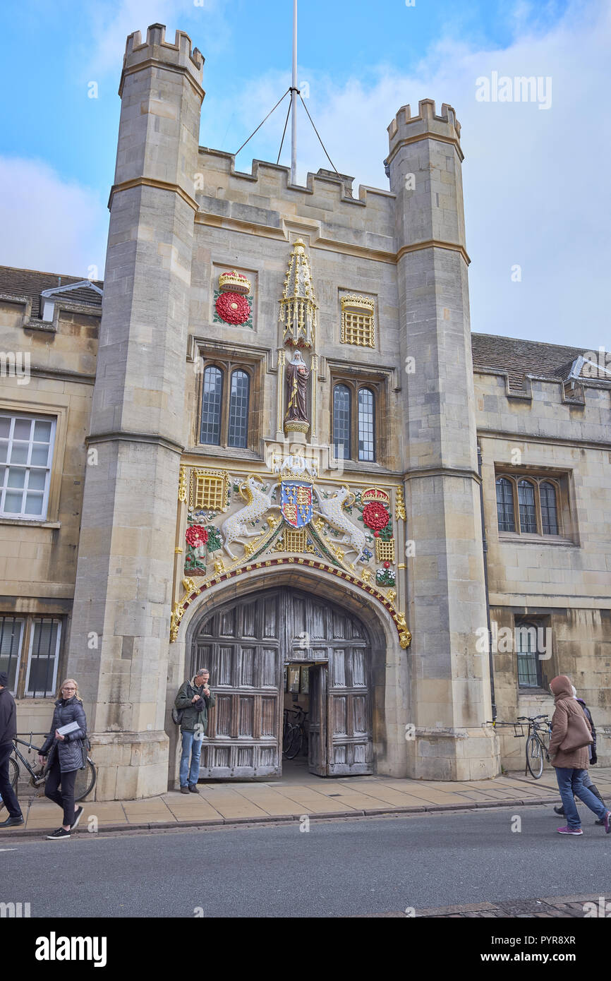 Refurbished, renewed, repainted emblems on the entrance facade tower wall to Christ college, university of Cambridge, England. - Stock Image
