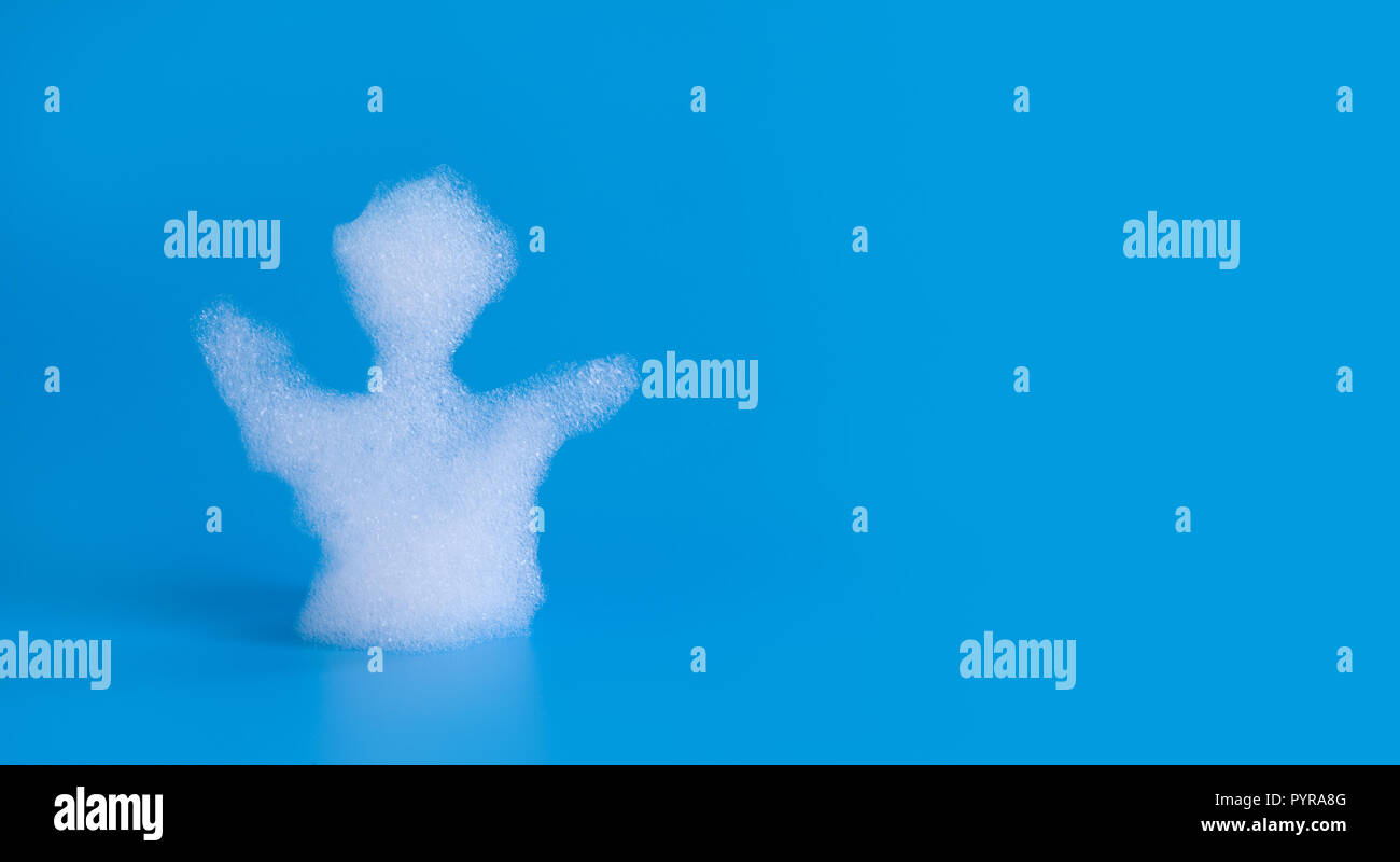 Soapy bubbles foam man silhouette on blue background. Suds shower texture macro view photo, shallow depth of field. Copy space. Stock Photo