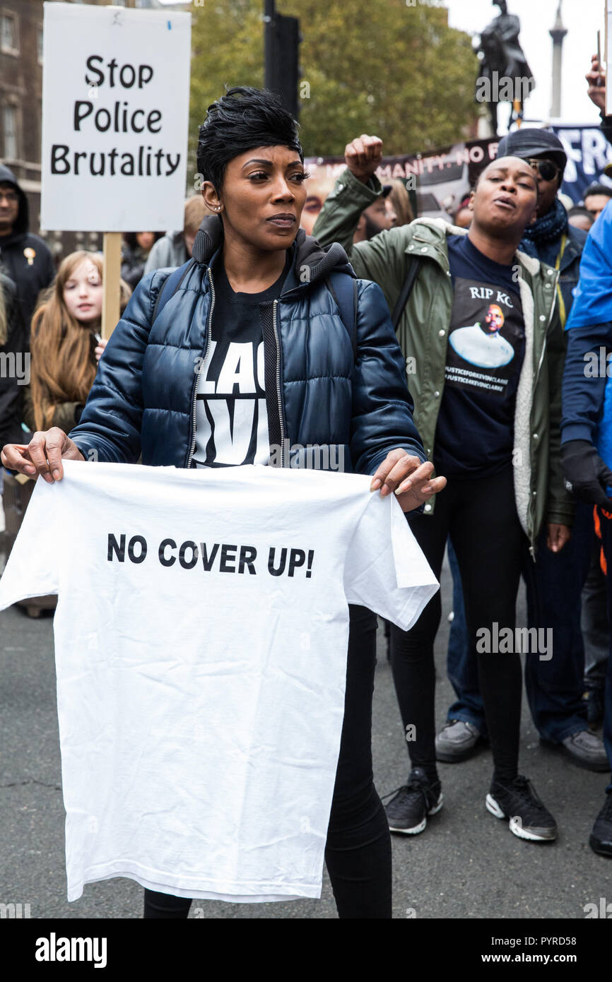 London, UK. 27th October, 2018. Kadisha Brown-Burrell, sister of Kingsley Burrell, marches with fellow campaigners from the UFFC. - Stock Image