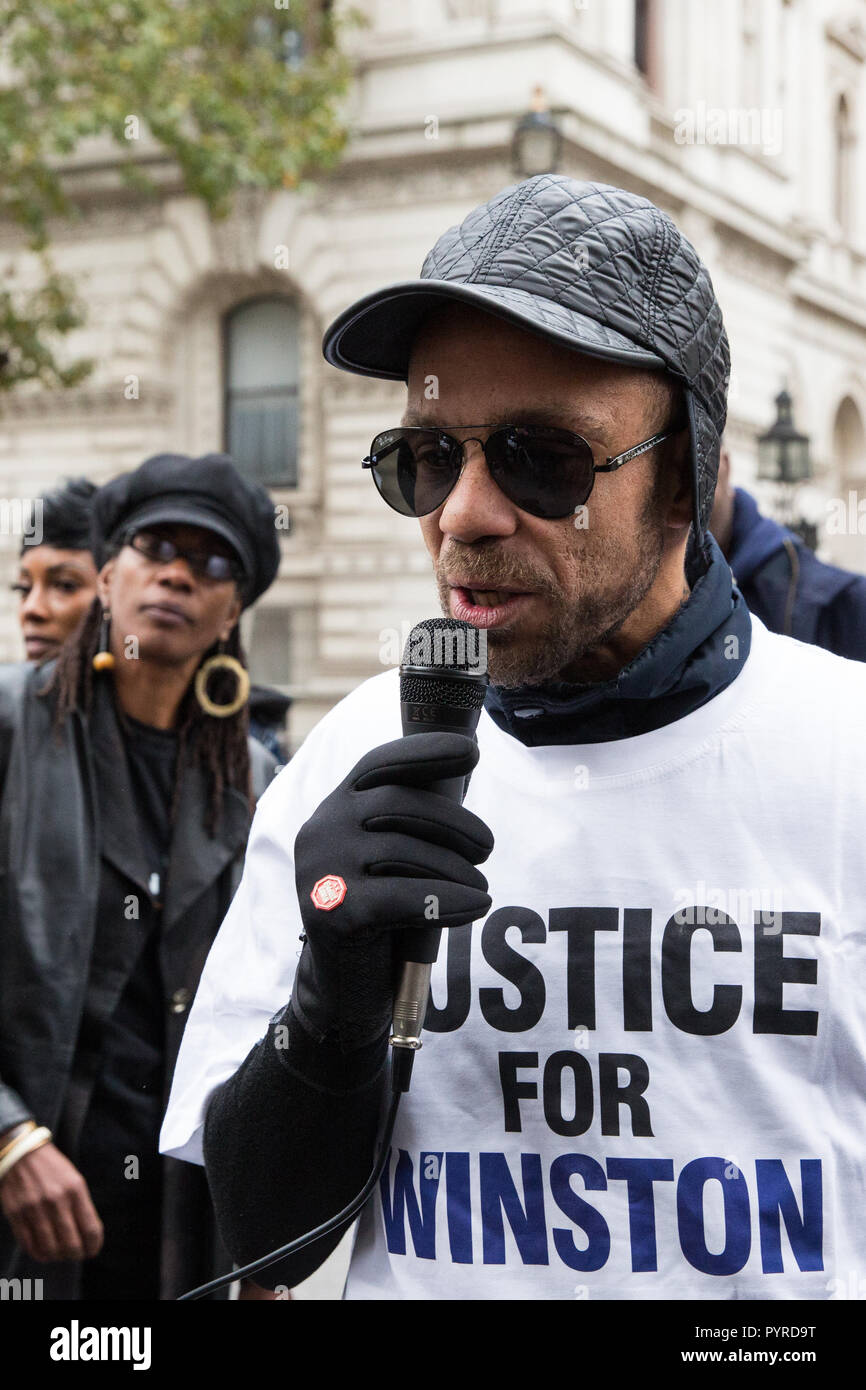 London, UK. 27th October, 2018. Darren Augustine, brother of Winston Augustine, addresses campaigners from the United Families and Friends Campaign. - Stock Image