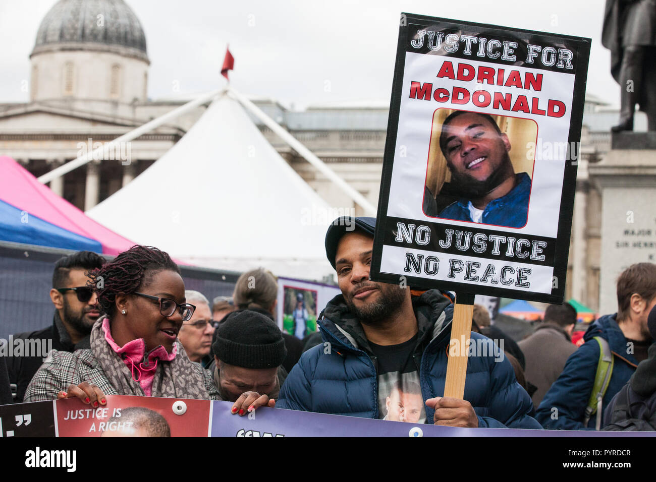 London, UK. 27th October, 2018. The Justice for Adrian McDonald campaign prepares to march with the United Families and Friends Campaign to Downing St - Stock Image