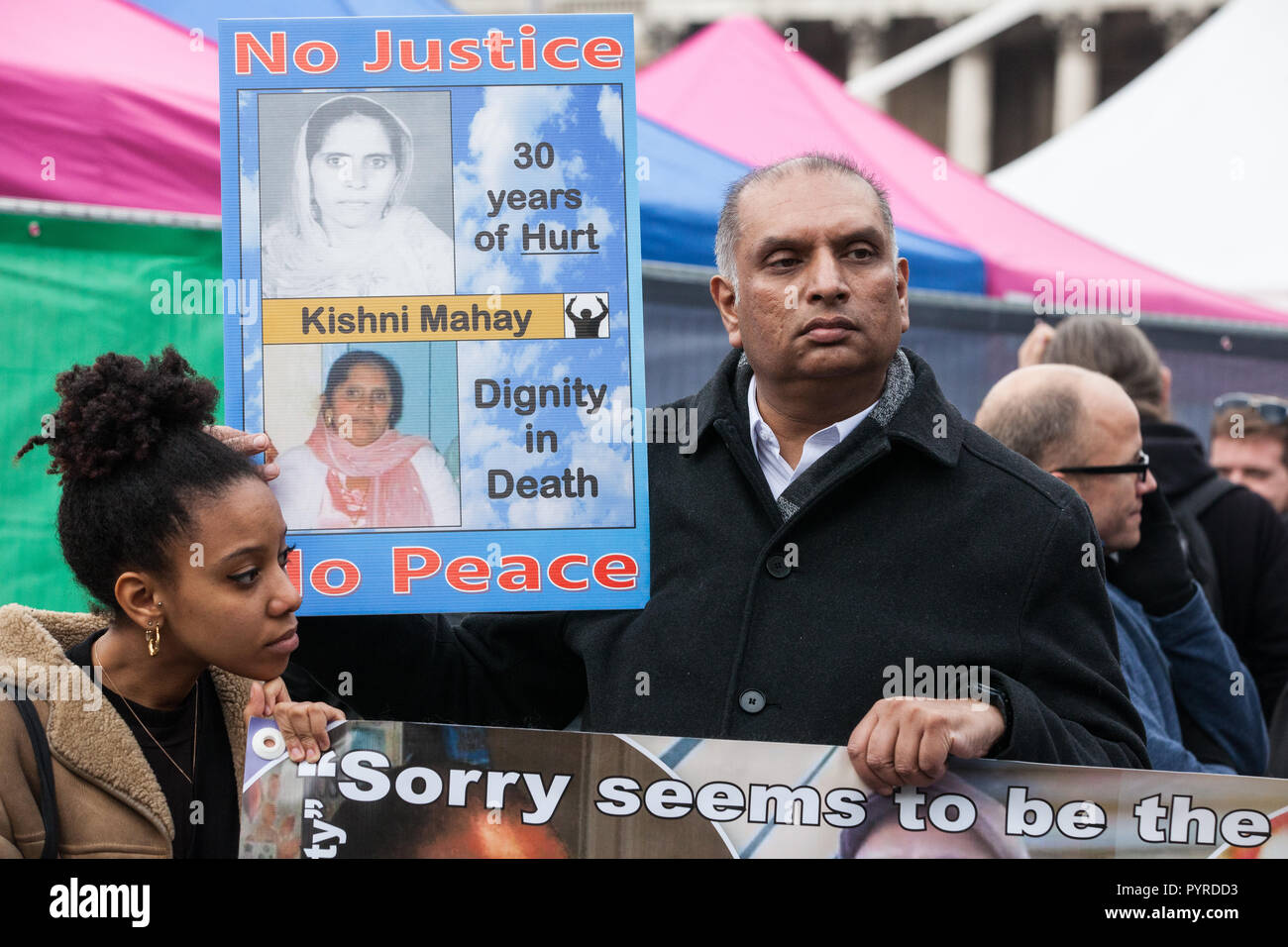 London, UK. 27th October, 2018. Raj Mahay, son of Kishni Mahay, prepares to march with the United Families and Friends Campaign to Downing Street. - Stock Image
