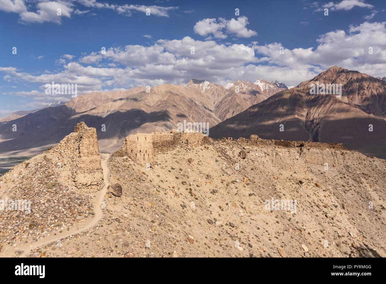 Yamchun fortress in golden light with views of Panj River and Hindu Kush, Yamchun, Wakhan Valley, Tajikistan - Stock Image