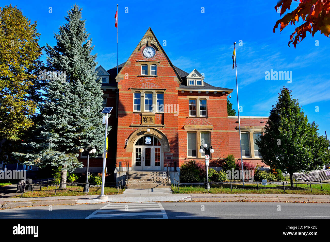 A landscape image of an iconic  brick building situated in the center of the town of Sussex that was built in 1883 and now used as the town hall - Stock Image