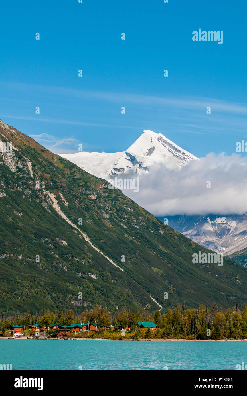 Redoubt Mountain Lodge on Crescent Lake with Mount Redoubt, Lake Clark National Park and Preserve, Alaska, USA. - Stock Image