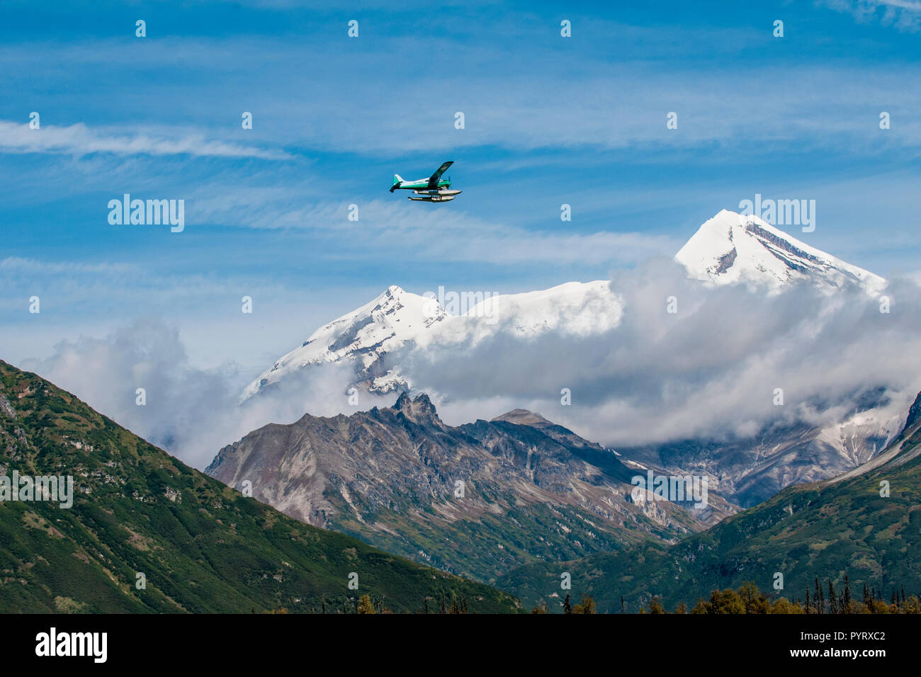 Float floatplane and Mount Redoubt, Lake Clark National Park and Preserve, Alaska, USA. - Stock Image