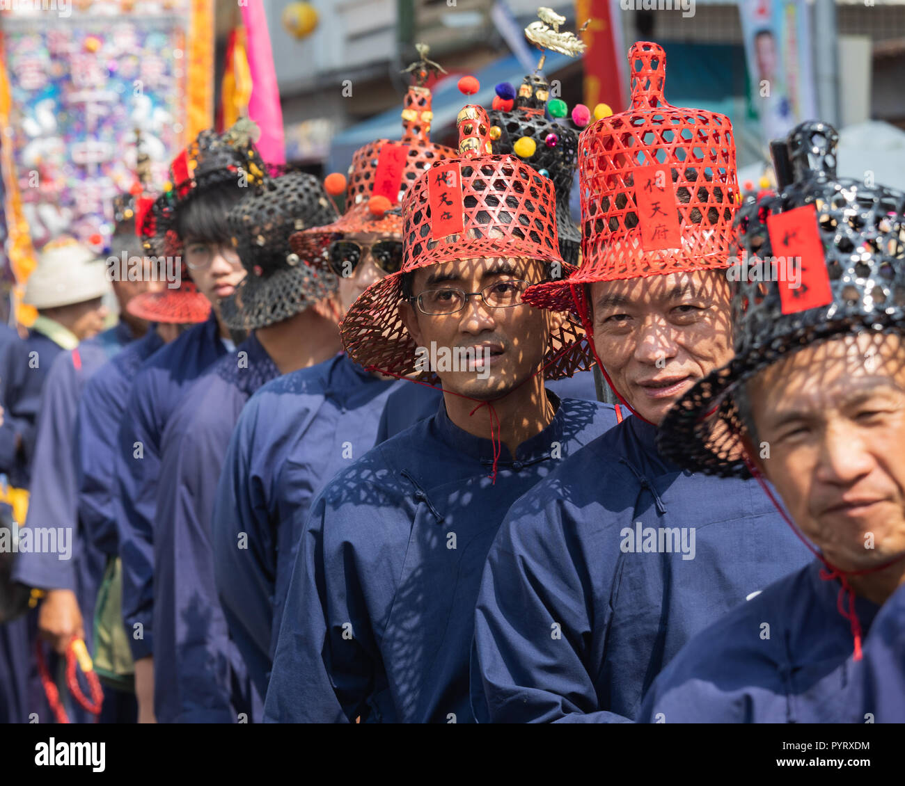 Officials from the Donglong Temple in Donggang participate in a parade in Donggang in southern Taiwan. - Stock Image