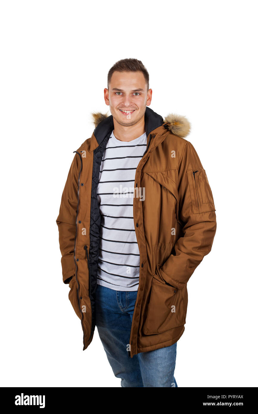 3251c9329cc Handsome young man wearing a light brown winter parka jacket - smiling to  the camera on