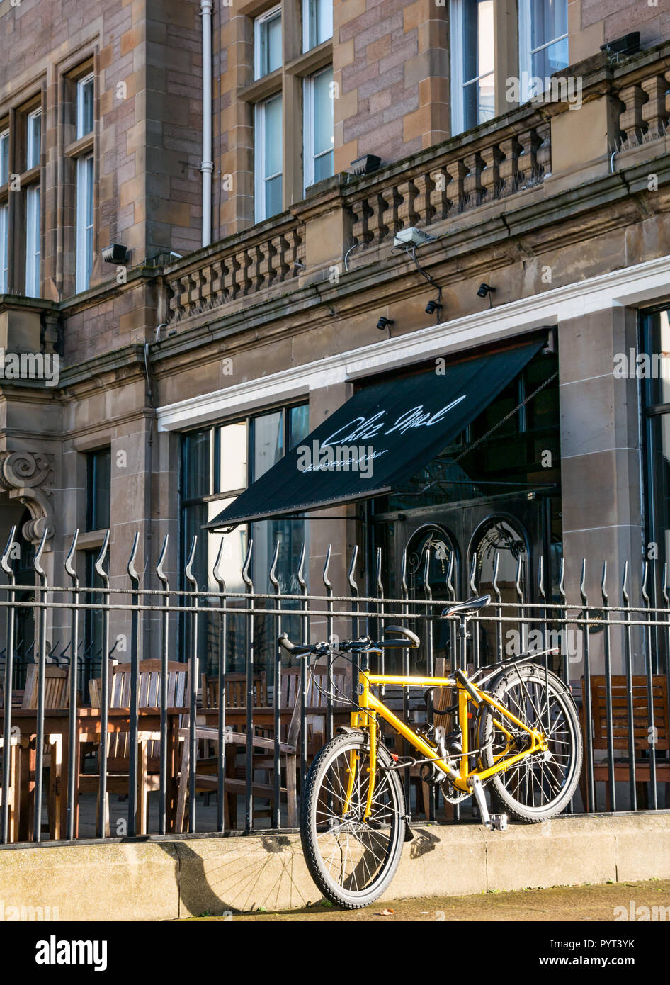 Front of Chez Mal brasserie restaurant at Malmaison Hotel with yellow bicycle locked to railings, The Shore, Leith, Edinburgh, Scotland, UK - Stock Image