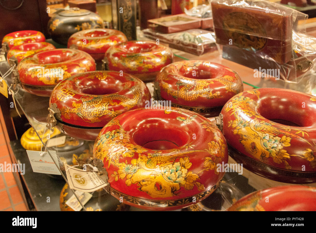 A lot of Chinese special bright colored caskets close-up. Celebration parts. Ancient traditional tools. - Stock Image