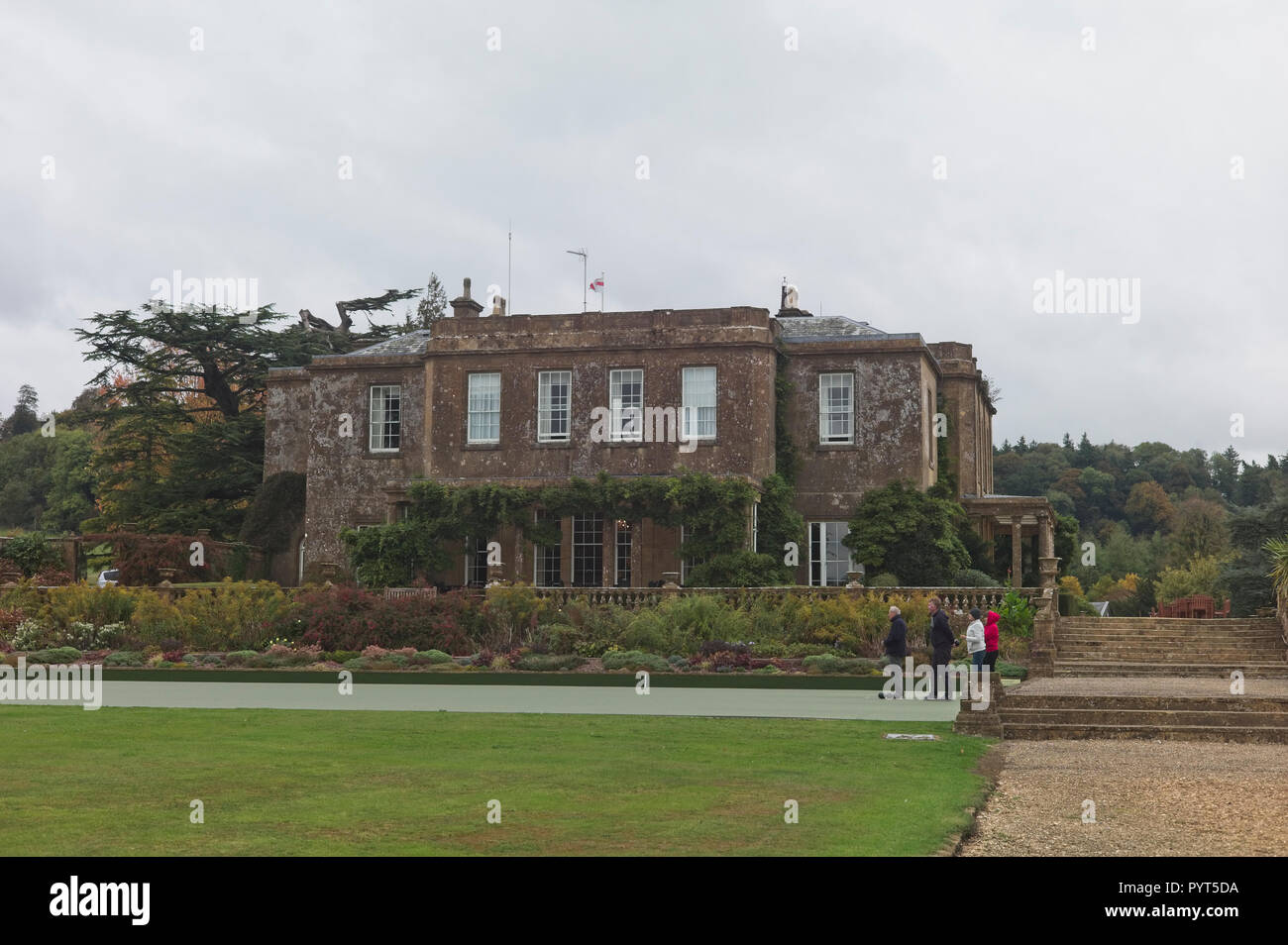 Cricket St Thomas Warner Hotel in Somerset, England. Four people playing bowls on a cold grey day - Stock Image