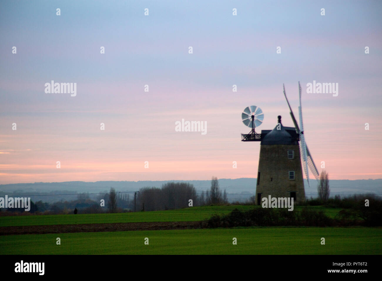 Great Haseley Windmill silhouetted against evening sky at sunset, near Great Milton, Oxfordshire - Stock Image
