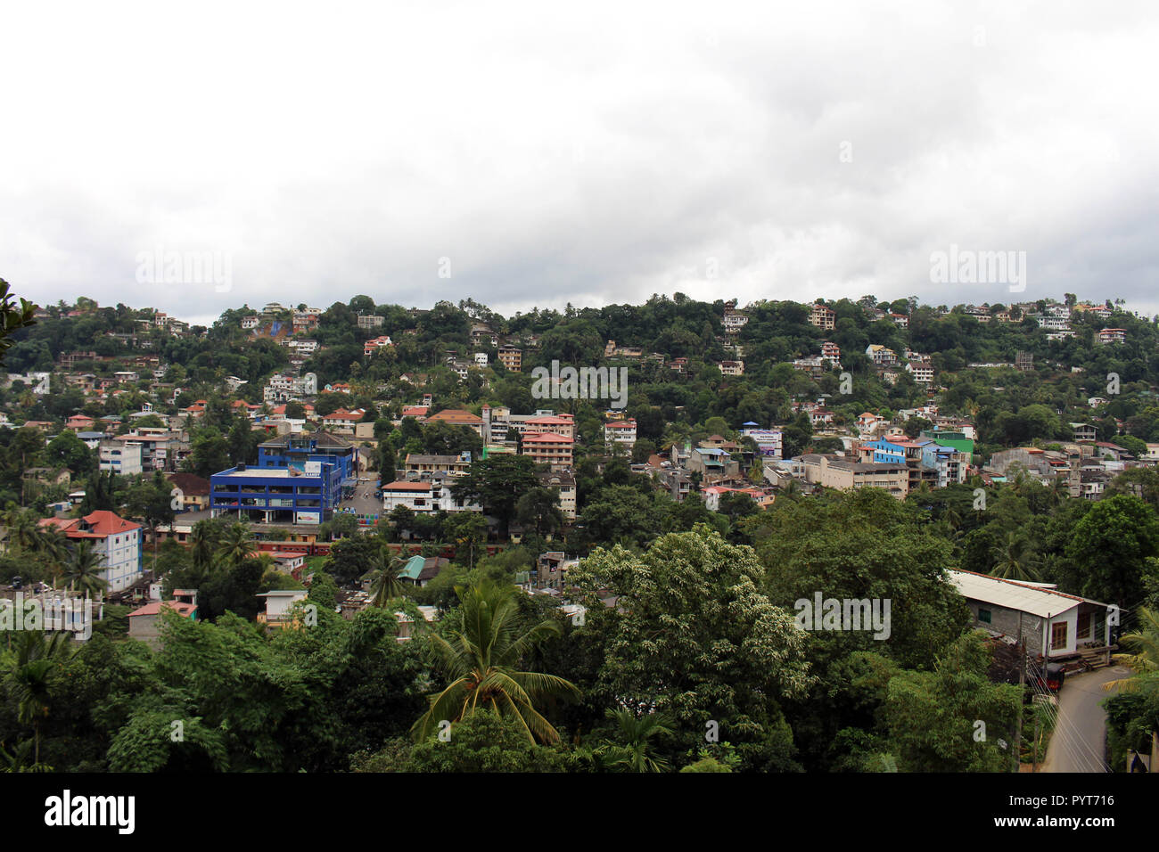 Translation: Around Kandy hill in the cloudy morning and a train passing by. Taken in Sri Lanka, August 2018. Stock Photo