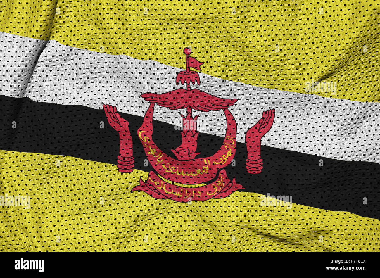 Brunei Darussalam flag printed on a polyester nylon sportswear mesh fabric with some folds - Stock Image