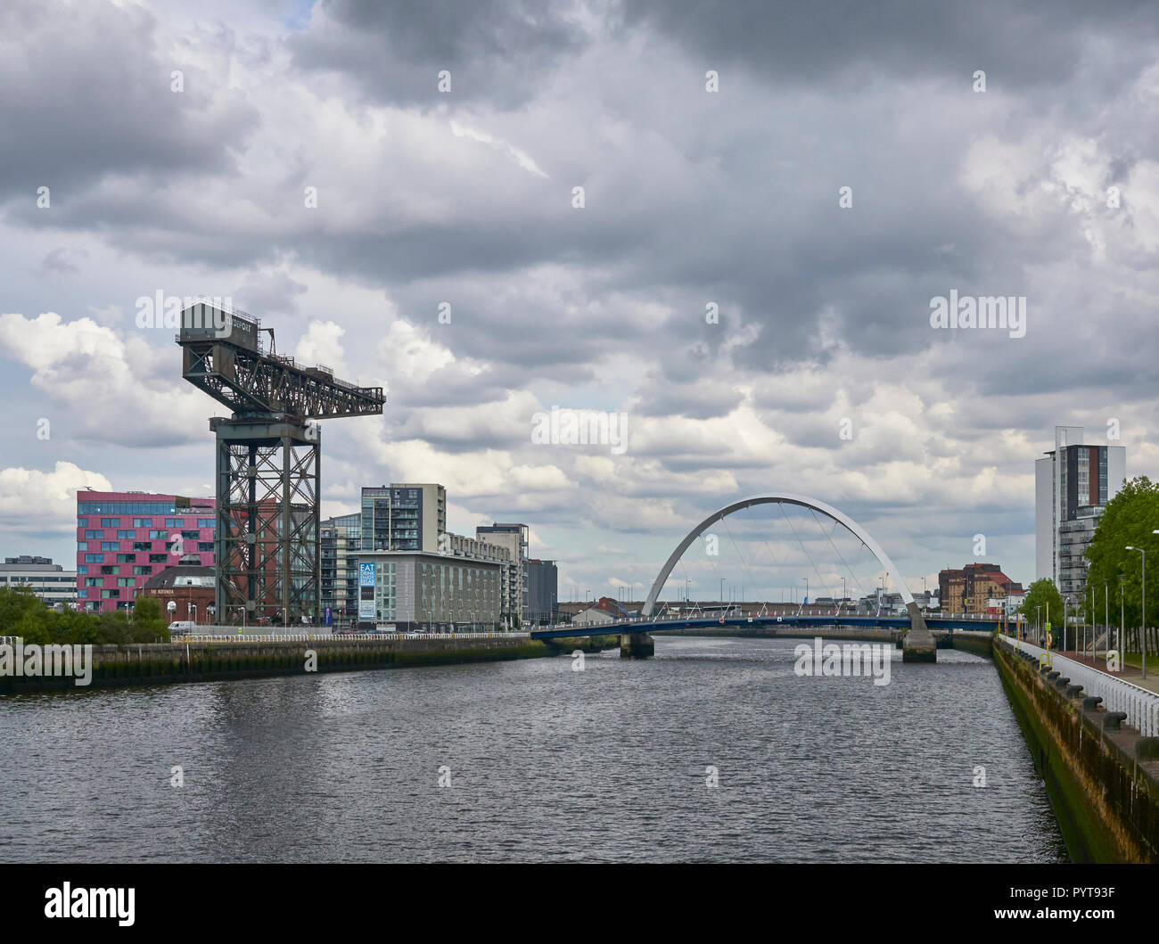 Looking East down the River Clyde towards the Finieston Crane and Squinty Bridge at Pacific Quay, Glasgow, Scotland, UK. Stock Photo