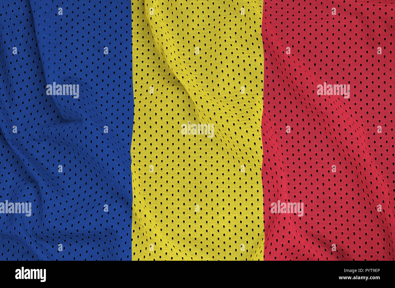 Romania flag printed on a polyester nylon sportswear mesh fabric with some folds - Stock Image