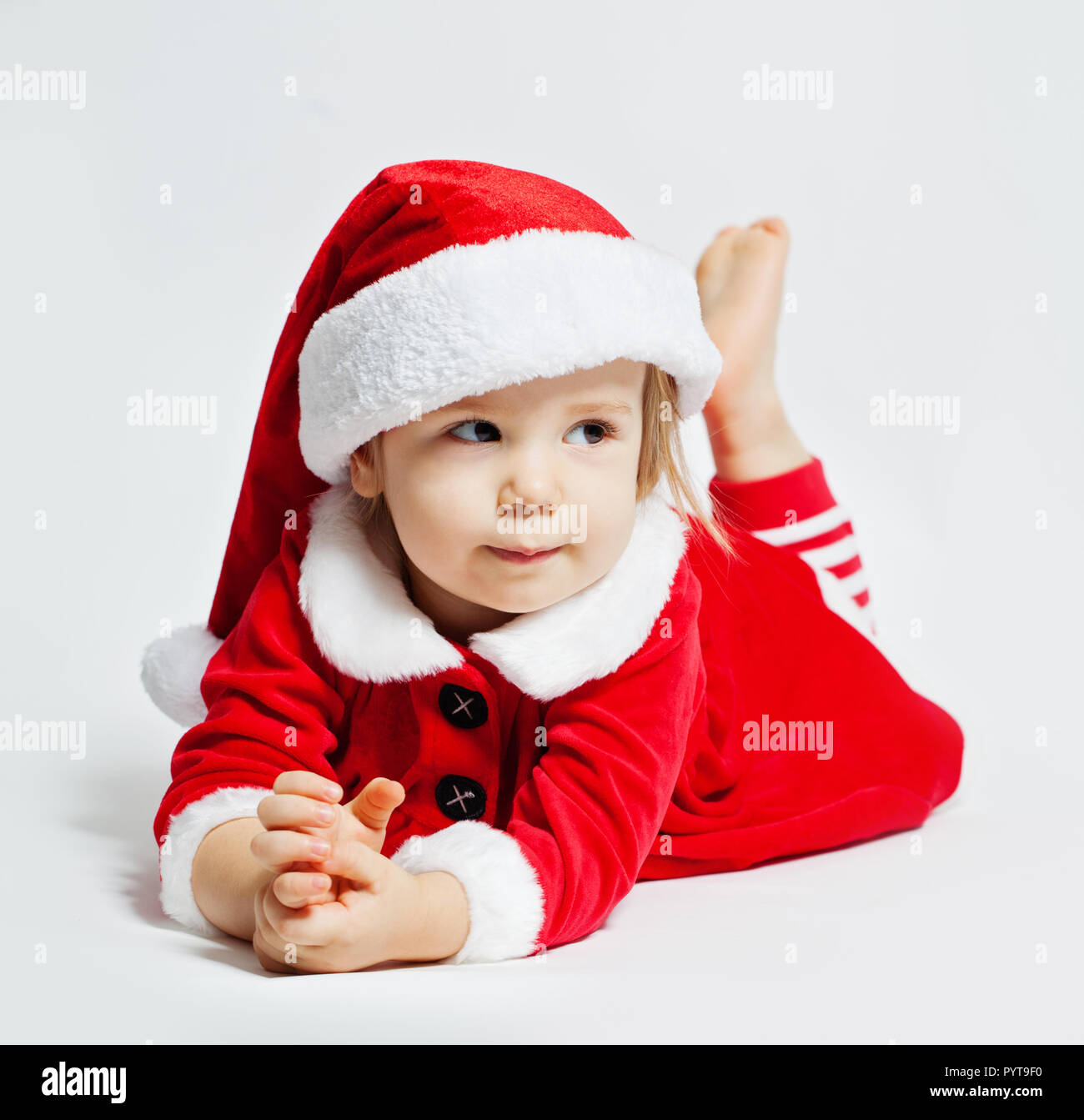 0d835c70f Portrait of cute baby in santa hat on white background Stock Photo ...