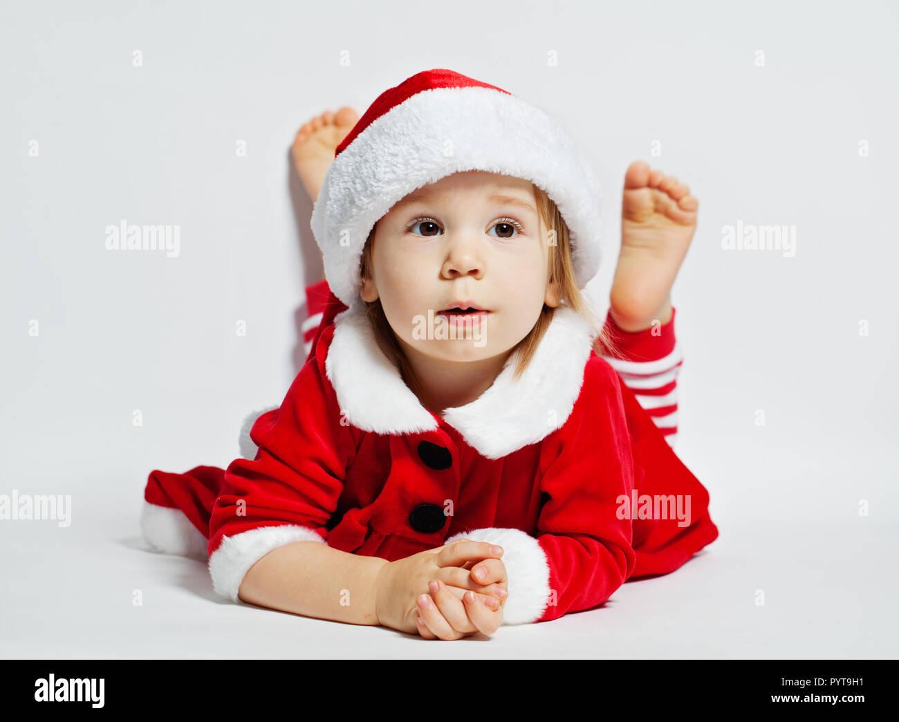 2e4aca26c Cute Baby Girl Wearing Santa Stock Photos & Cute Baby Girl Wearing ...