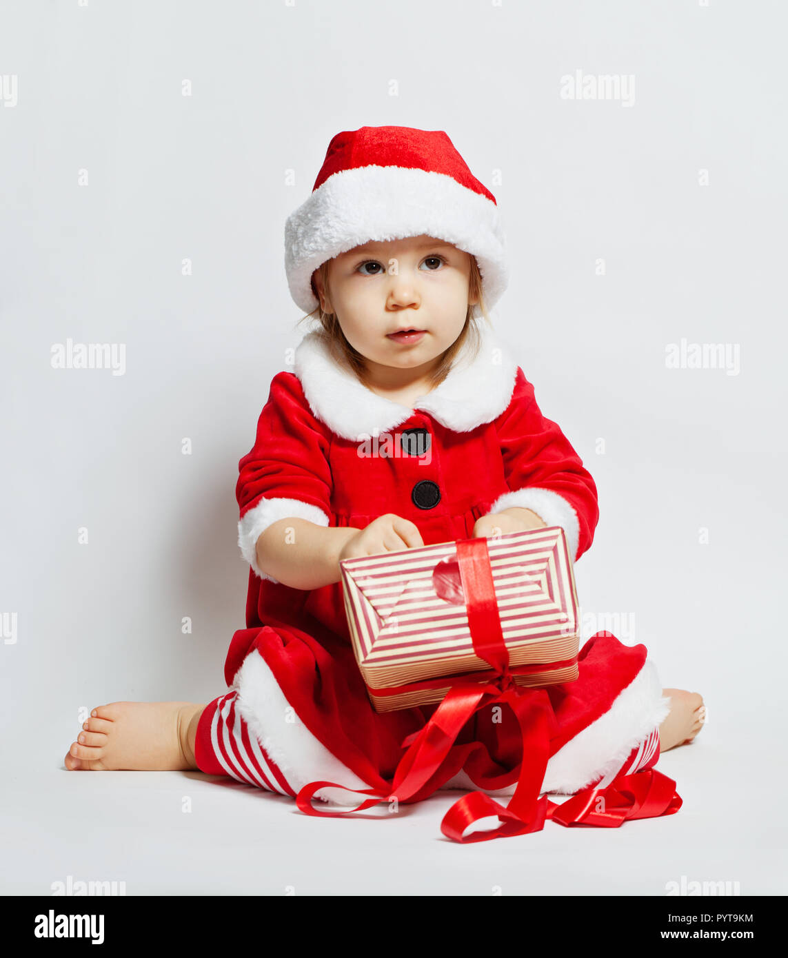 370be8bfe Cute baby in santa hat opening Christmas gift box Stock Photo ...