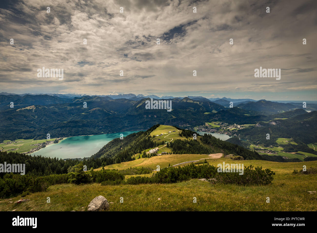Mountain landscape with hiking trail and view of beautiful landscape over the Wolfgangsee Stock Photo