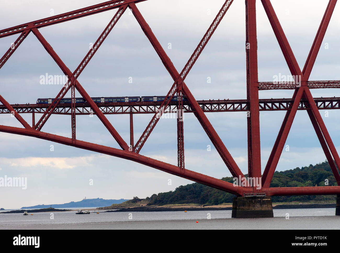 A Passenger Train Crossing the Forth Railway Bridge over The Firth of Forth at South Queensferry near Edinburgh Scotland United Kingdom UK Stock Photo