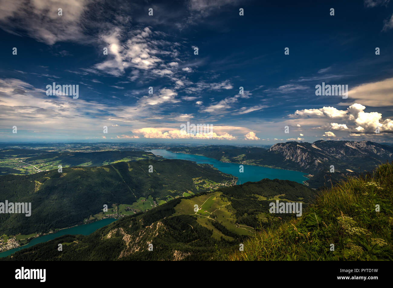 Mountain landscape on the top of the hiking trail to the Schafberg and view of beautiful landscape over the Attersee lake Stock Photo