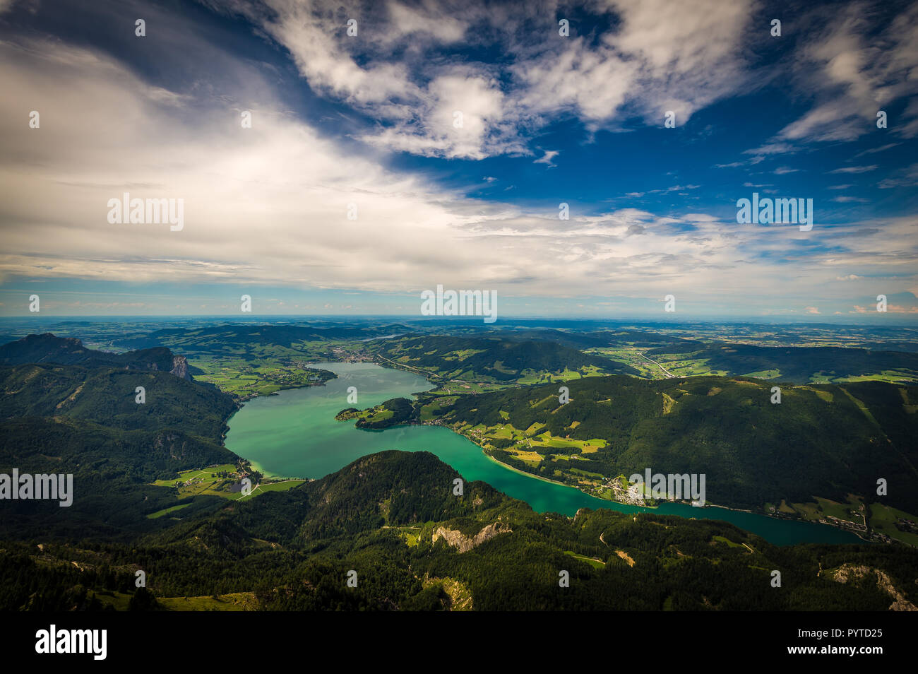 Mountain landscape on the top of the hiking trail to the Schafberg and view of landscape over Mondsee Stock Photo