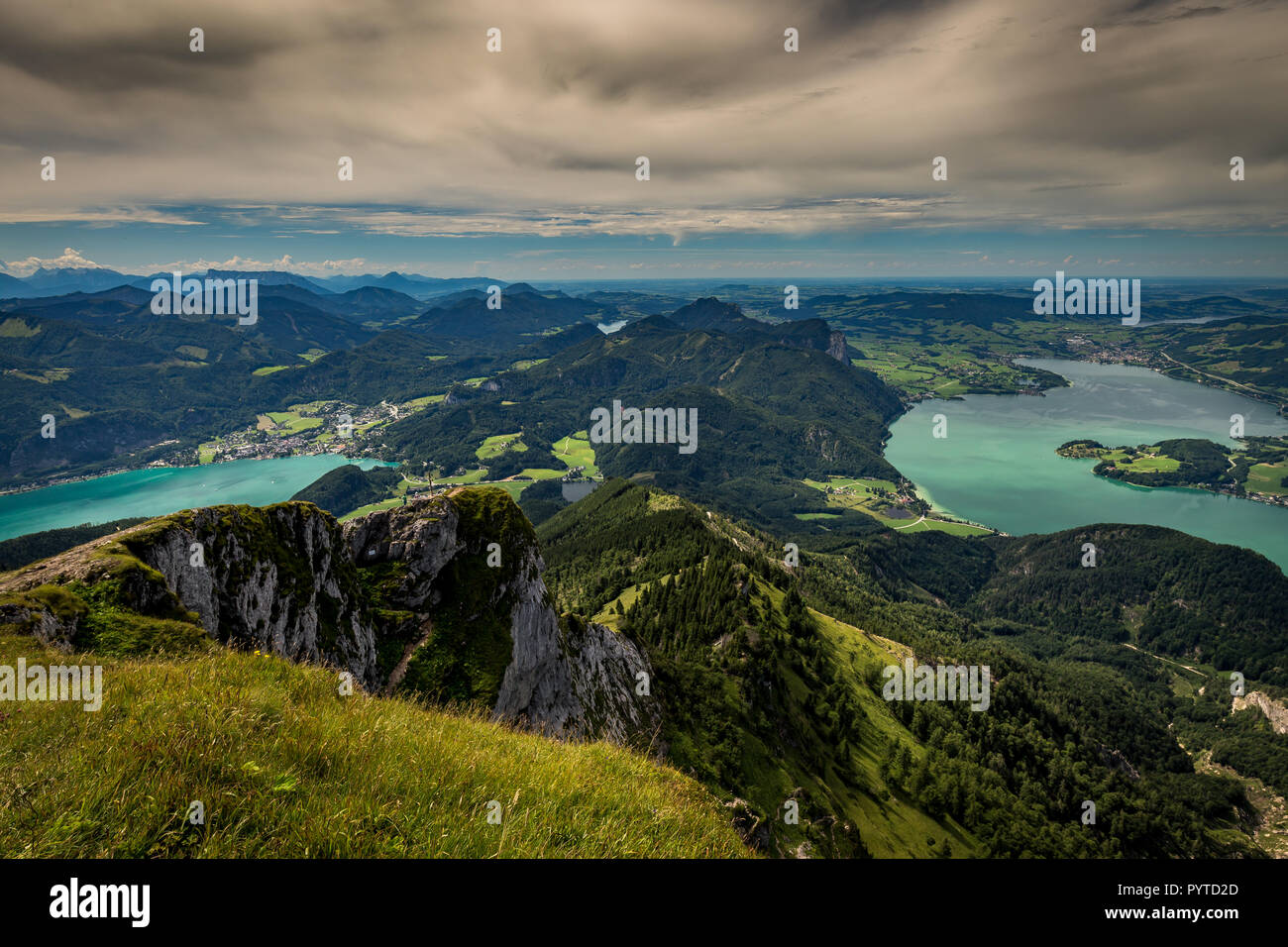 Mountain landscape on the top of the hiking trail to the Schafberg and view of landscape over the Wolfgangsee and Mondsee Stock Photo