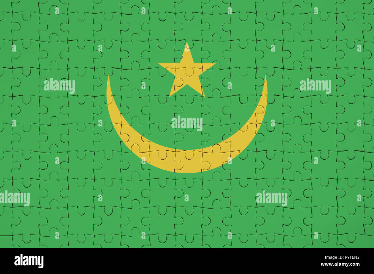 Mauritania flag  is depicted on a folded puzzle - Stock Image