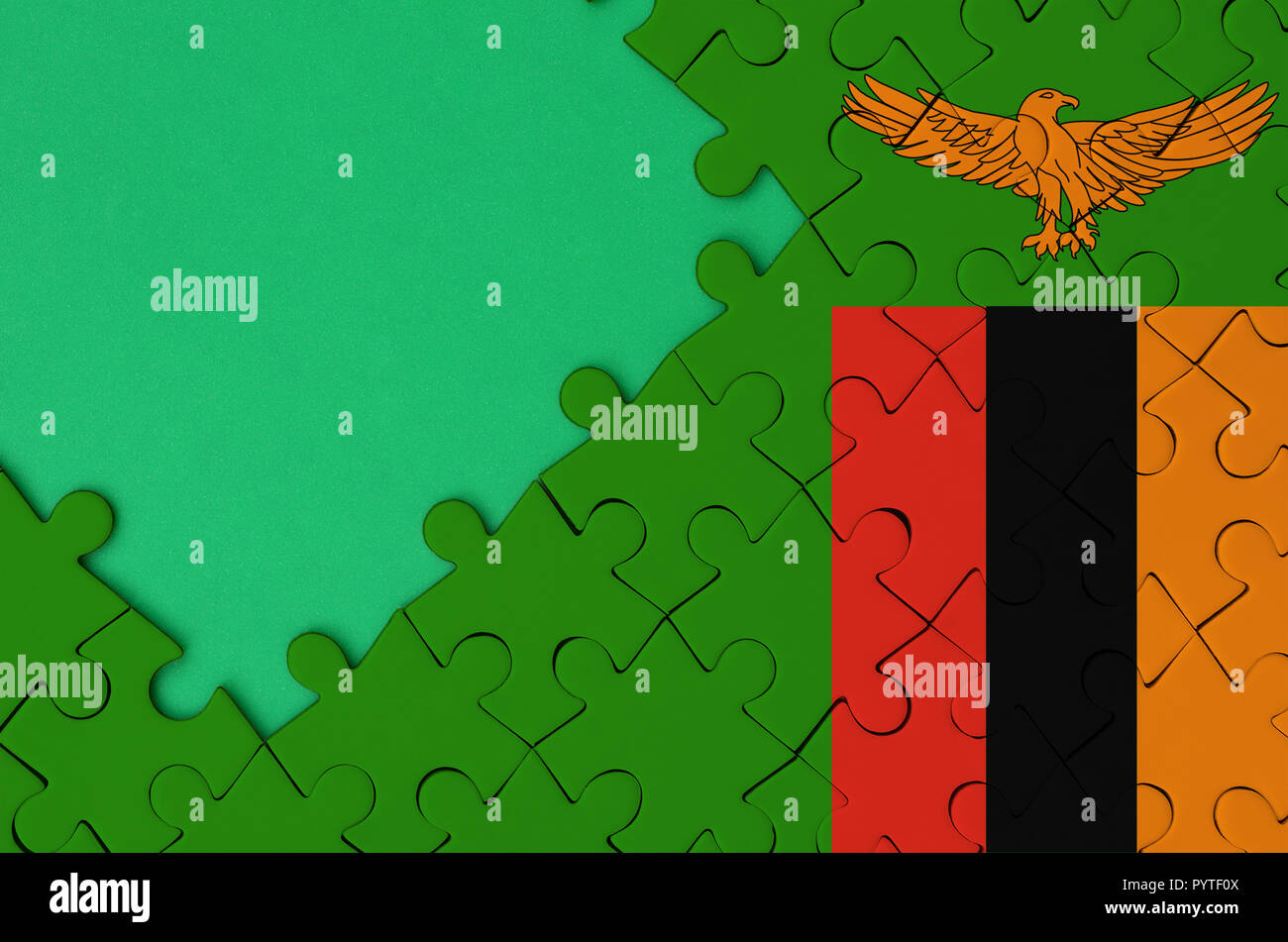 Zambia flag is depicted on a completed jigsaw puzzle with