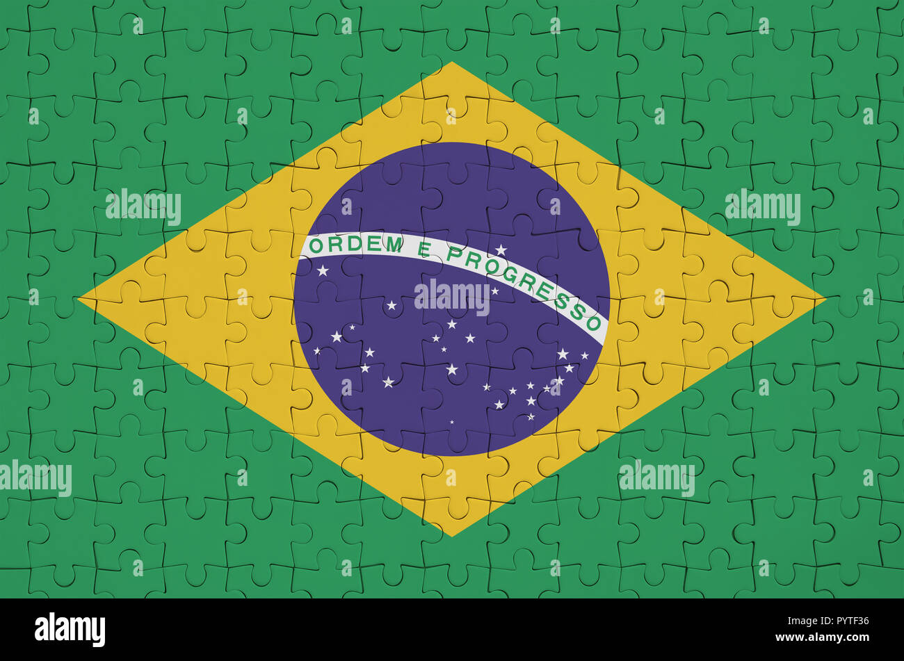 Brazil flag  is depicted on a folded puzzle - Stock Image