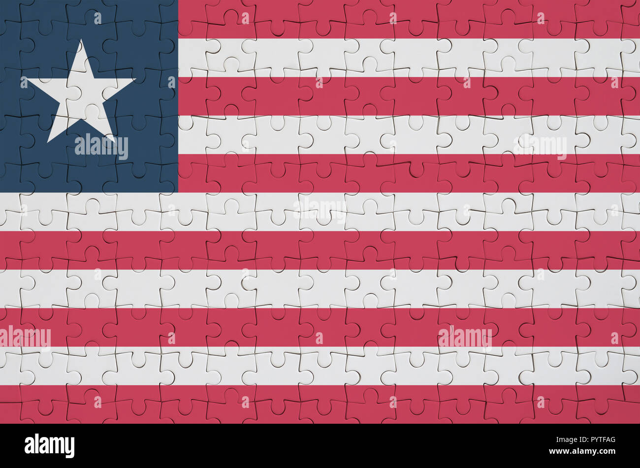 Liberia flag  is depicted on a folded puzzle - Stock Image