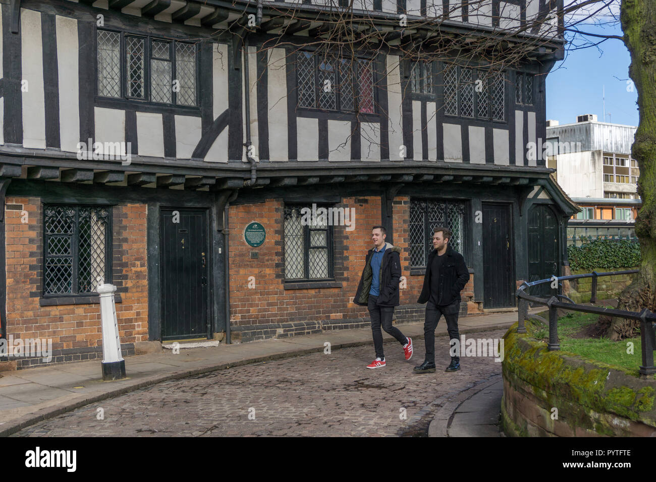 15th century Lychgate Cottages, named after the gate from which funerals once entered Holy Trinity graveyard; Coventry, West Midlands, UK - Stock Image