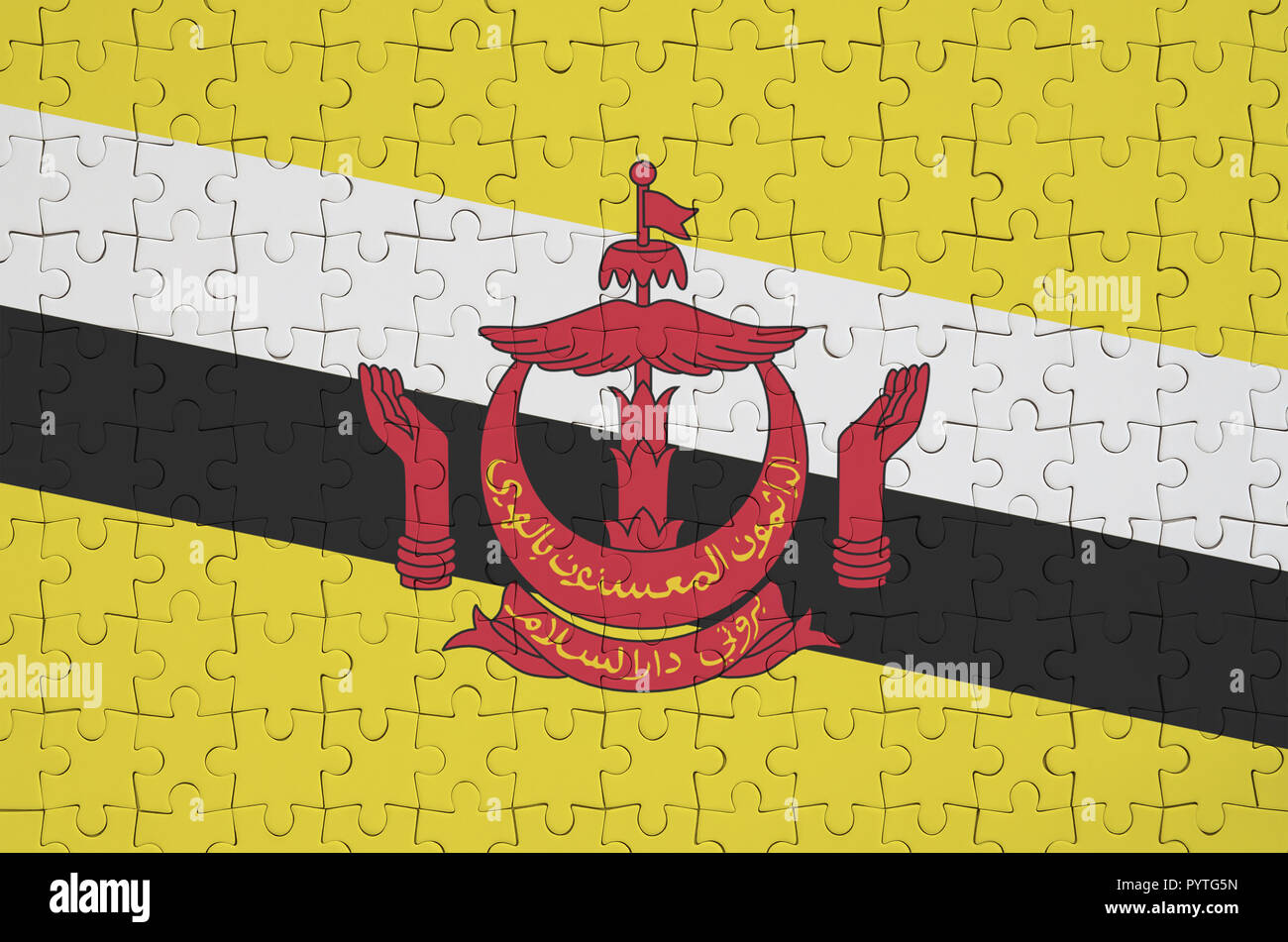 Brunei Darussalam flag  is depicted on a folded puzzle - Stock Image