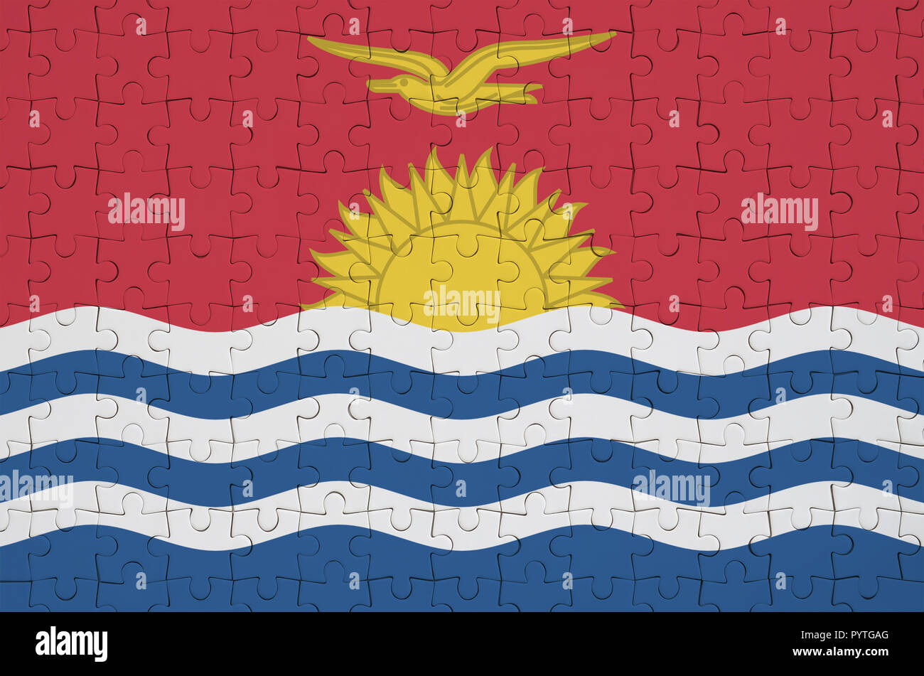 Kiribati flag  is depicted on a folded puzzle - Stock Image