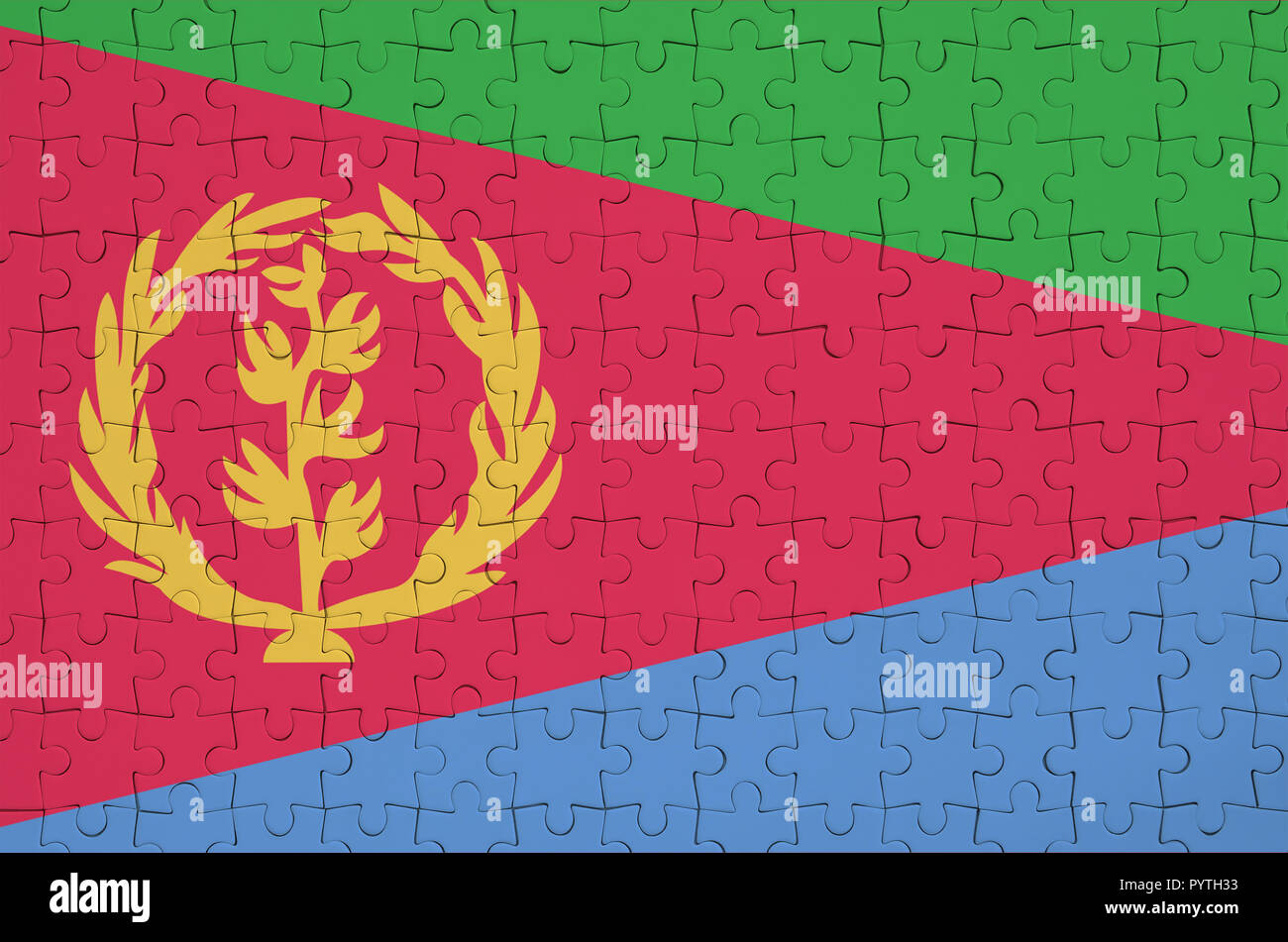 Eritrea flag  is depicted on a folded puzzle - Stock Image