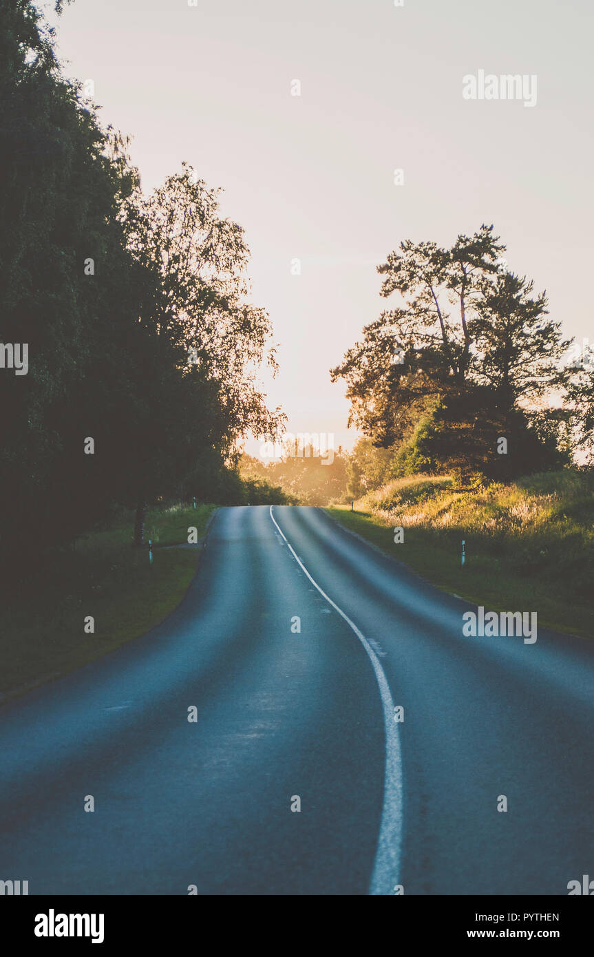 Walking up the road. - Stock Image