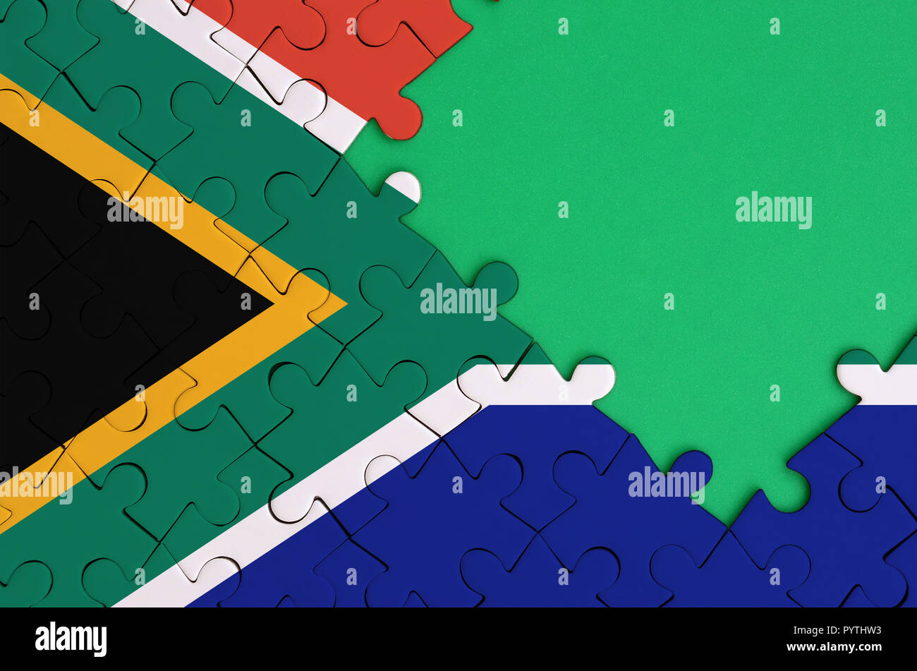 south africa flag is depicted on a completed jigsaw puzzle with free