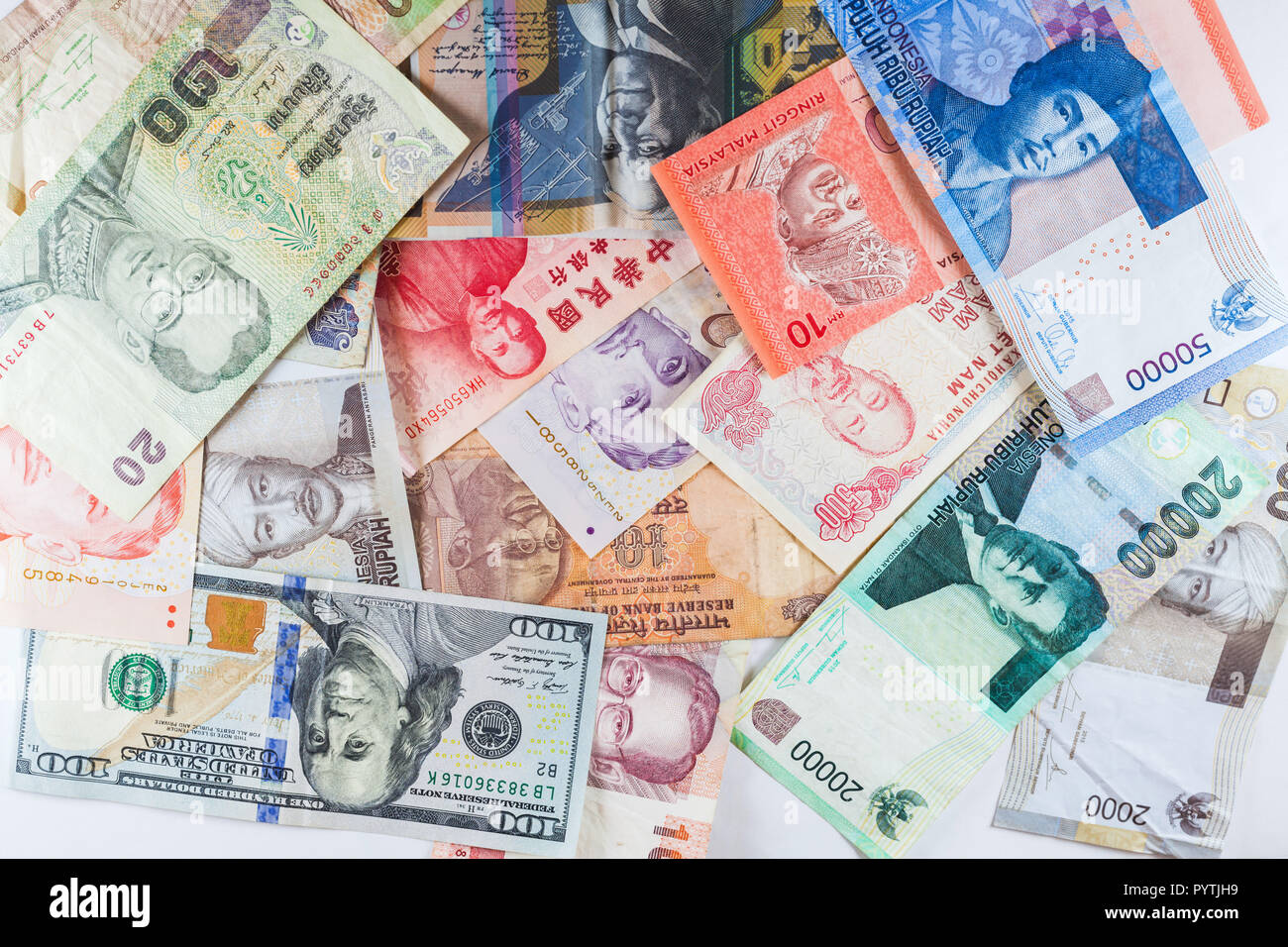 Multiple Currencies banknotes as colorful background showed the global money financial business economy crisis - Stock Image