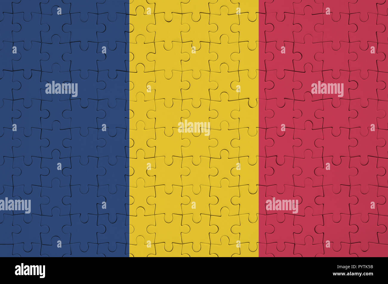 Chad flag  is depicted on a folded puzzle - Stock Image