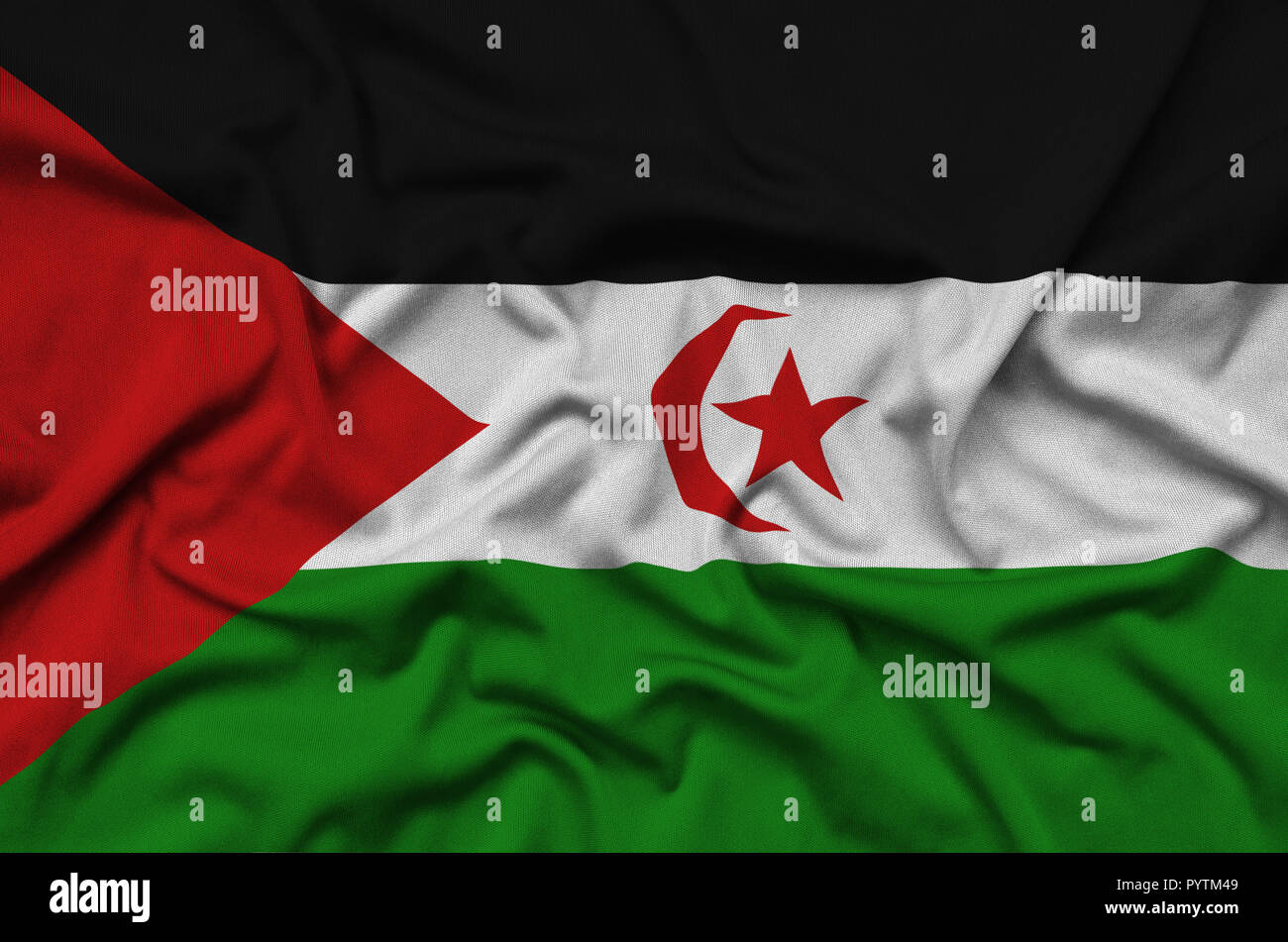 Western Sahara flag  is depicted on a sports cloth fabric with many folds. Sport team waving banner Stock Photo