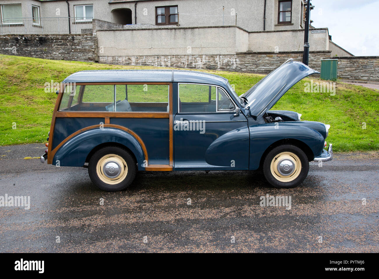 Classic Morris Minor Traveller viewed from the side with the bonnet open - Stock Image