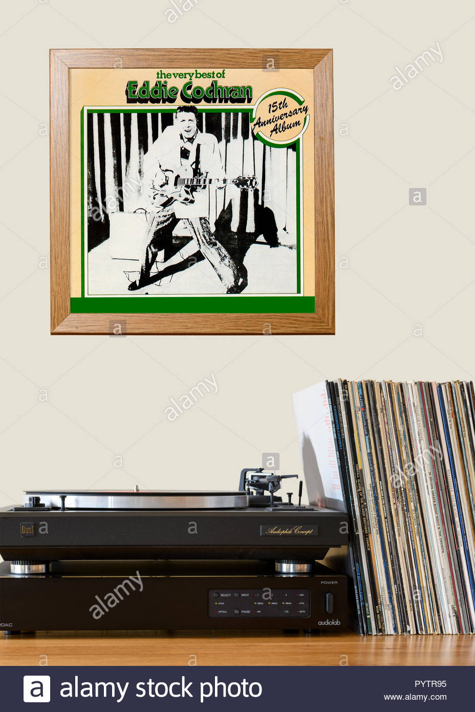 Record player and framed album cover Eddie Cochran best of album, England - Stock Image