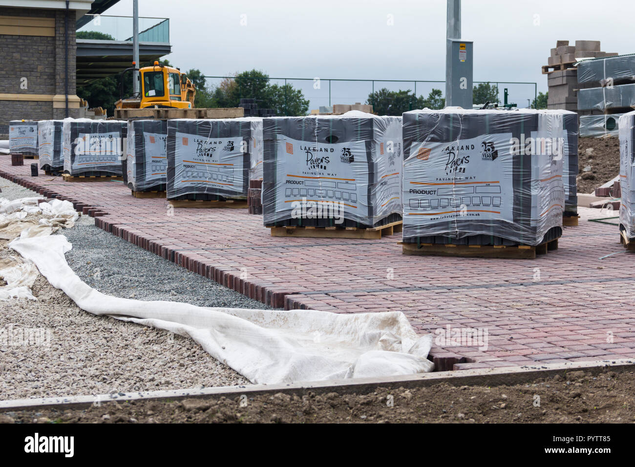 Block paving being laid with sub-base materials visible in the new car park at  Mint Bridge, the new rugby union football ground in Kendal, Cumbria.   - Stock Image
