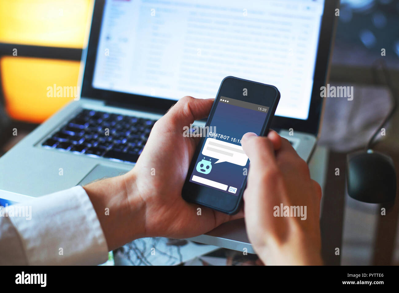 chatbot concept, online assistance, chat robot answering questions of user on website - Stock Image