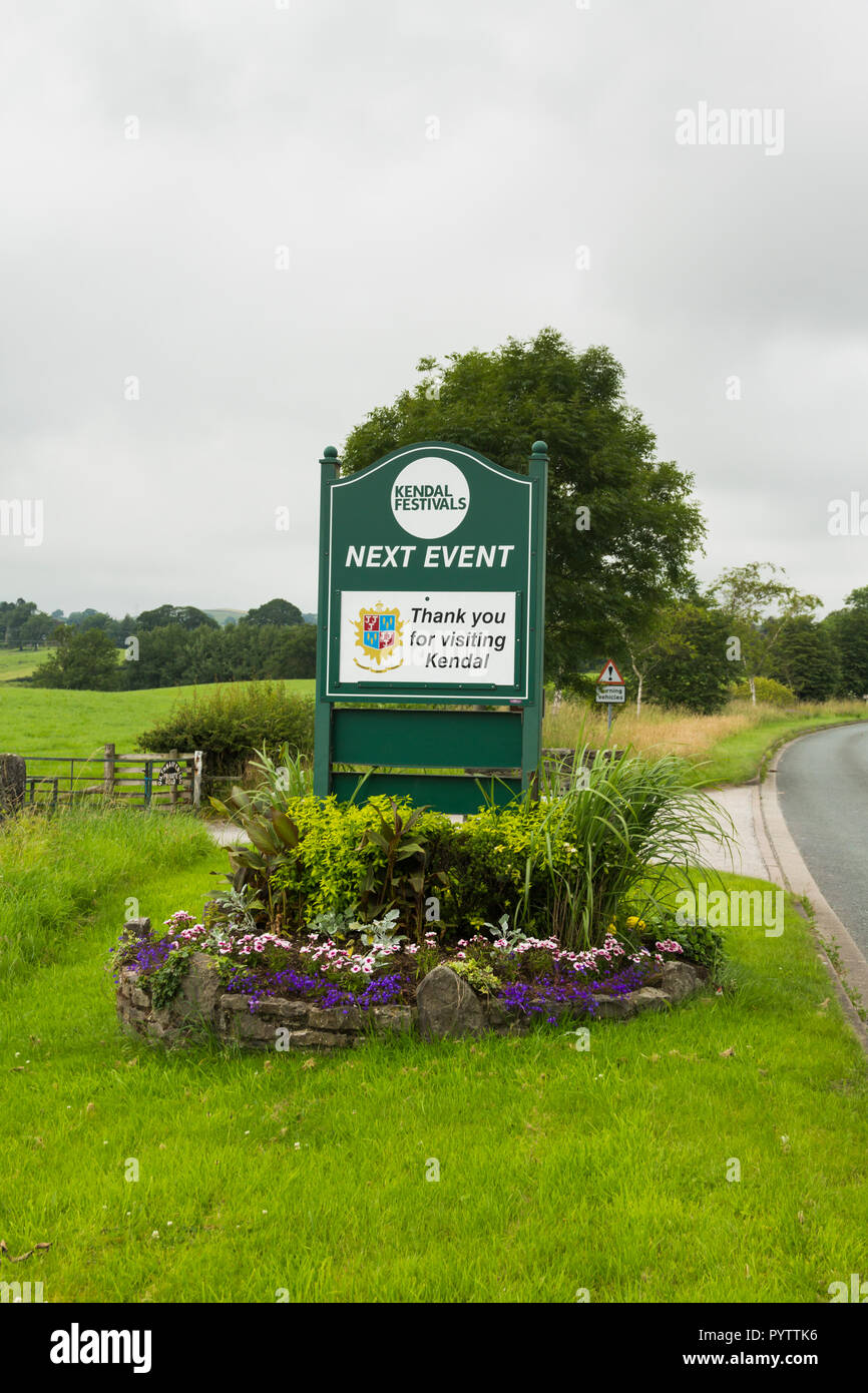 Thank you for visiting Kendal sign and flowerbed on Shap Road, the A6 road, north east of Kendal. Stock Photo