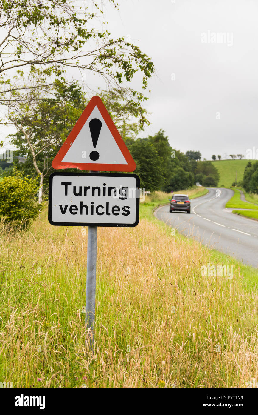 Turning vehicles warning road sign near a caravan and camping site on the A6 road near Kendal. Stock Photo
