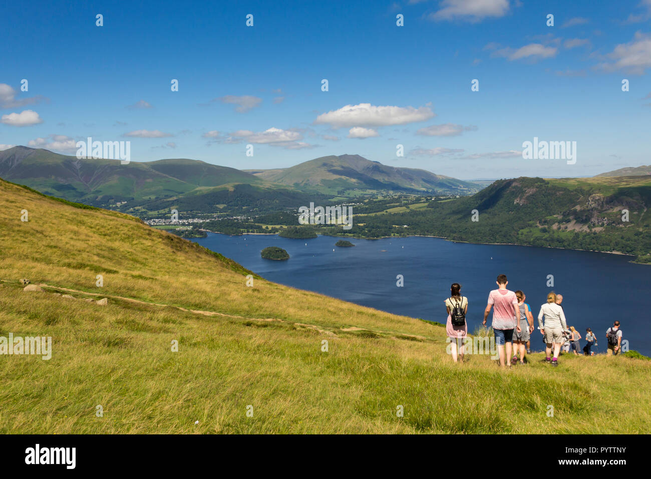 A group of young people walking near the summit of  Cat Bells (451 metres) Keswick, Cumbria, heading towards the shores of Derwent Water. Stock Photo