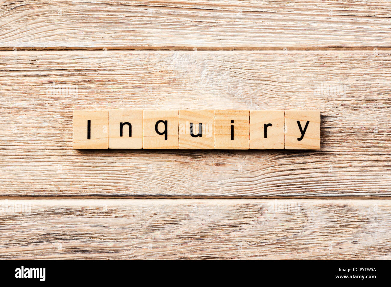 inquiry word written on wood block. inquiry text on table, concept. - Stock Image