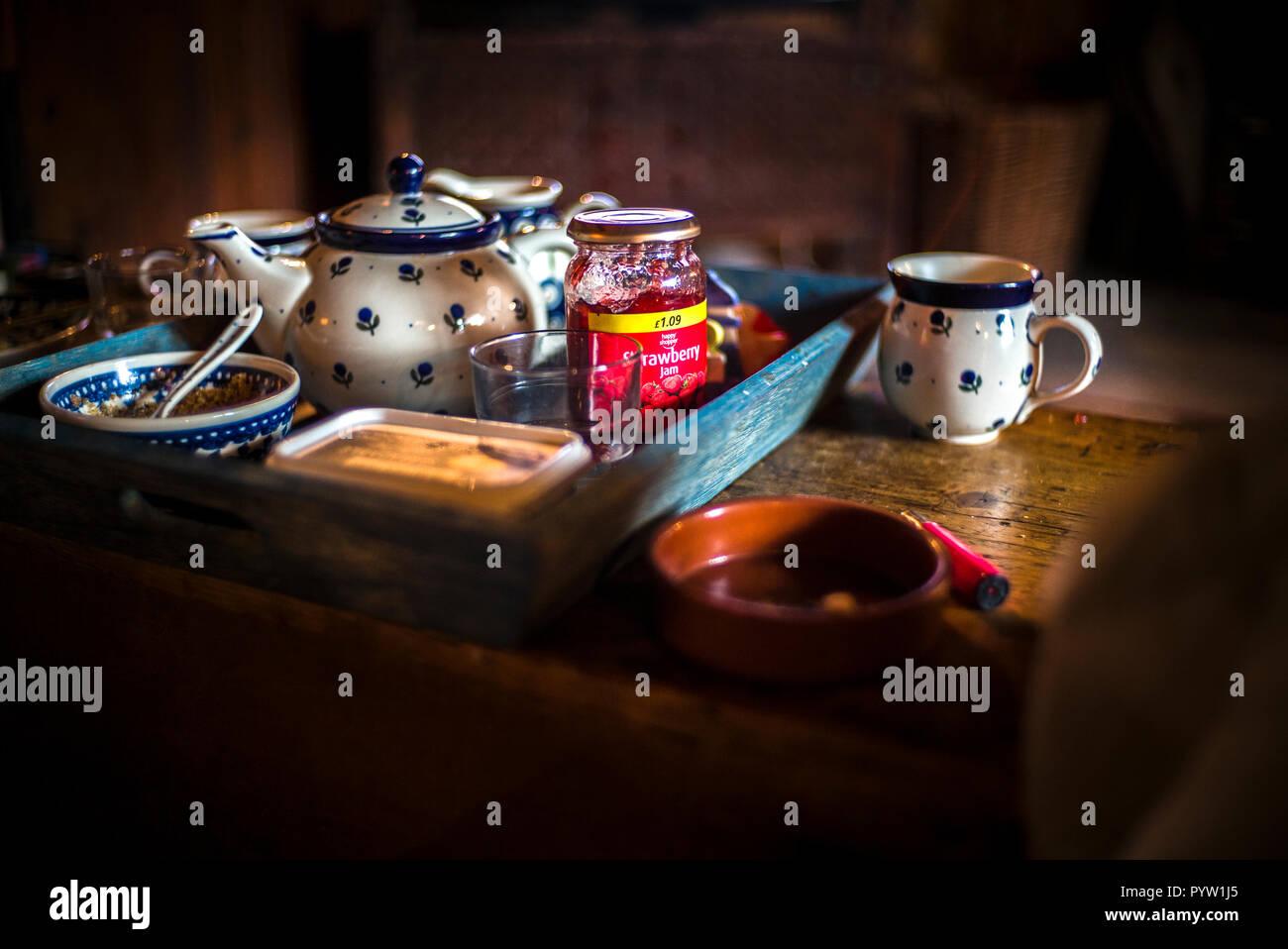 tea tray laid with mugs teapot strawbery jam milk bowl sugar bowl Stock Photo